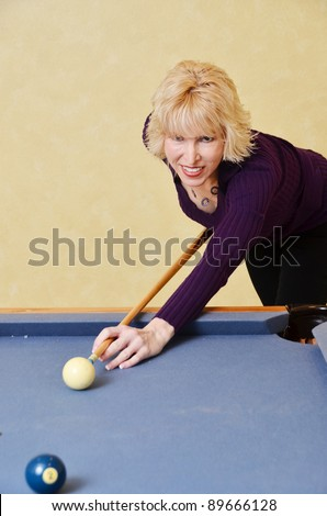 Woman at pool table/Woman at Pool Table/Woman playing a game of pool