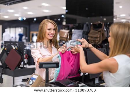Woman at the checkout makes shopping