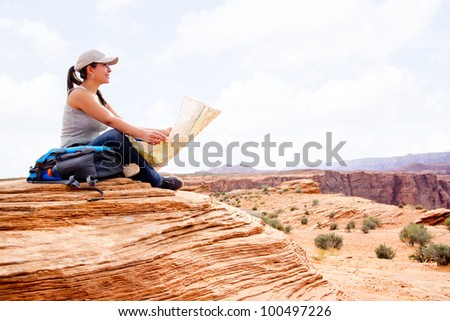 Woman at the Grand Canyon holding a map