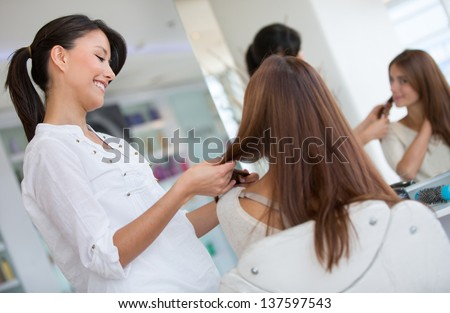 Woman at the hair salon getting a haircut beauty concepts