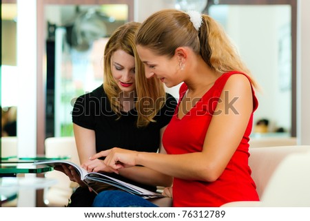Woman at the hairdresser getting advise on her hair styling or new hair color
