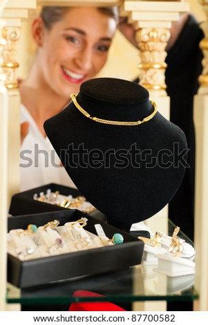 Woman at the jeweller is looking for jewellery
