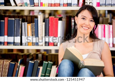 Woman at the library reading a book