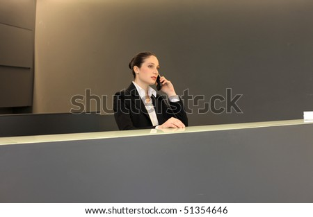 Woman at the reception at the telephone