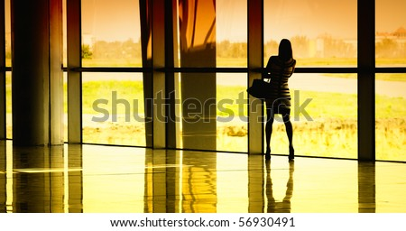 woman at the window at the airport