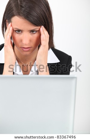 Woman at work with a headache