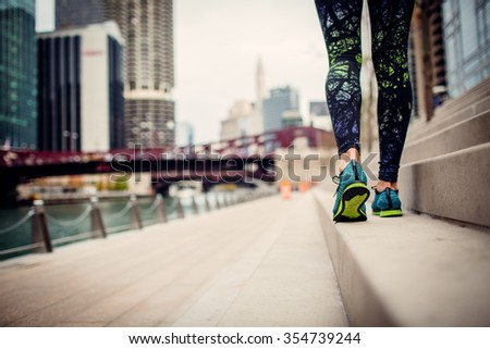 woman athlete feet and shoes while running in the city