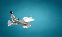 Woman Aviator floating in sky . Mixed media