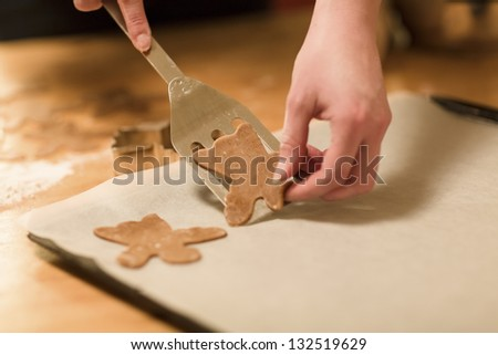 Woman baking ginger bread for Christmas. Natural Colors. Real life