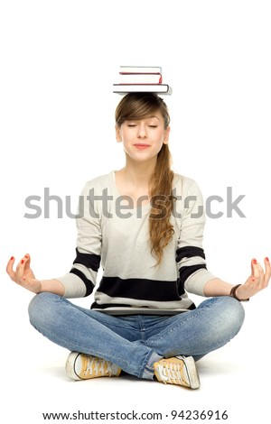 Woman balancing books on head