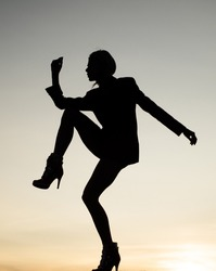 Woman ballet dancer dancing silhouette evening sky, girl