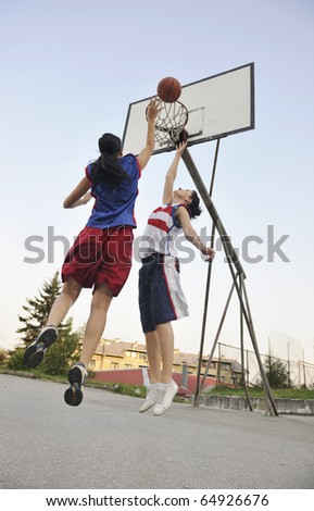 woman basketball player have treining and exercise at basketball court at city on street