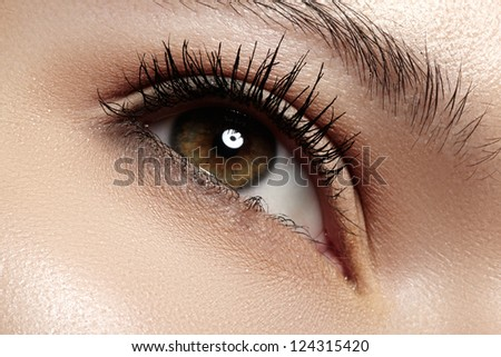 Woman beautiful eye with naturally long eyelashes. Macro shot. Wellness and spa, health and cosmetics. Natural make-up with black mascara on lashes. Long naturel eyelashes
