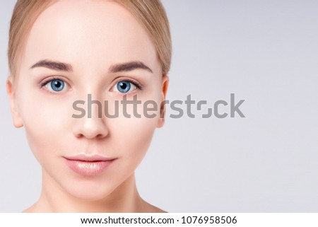 Woman beautiful face portrait. Beauty Portrait. Beautiful Spa model Girl with Perfect Fresh Clean Skin. Blonde female looking at camera. Youth and Skin Care Concept.