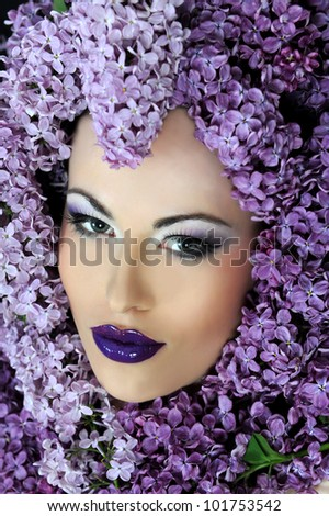 woman beautiful face with flower lilac frame - stock photo