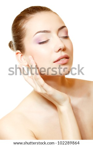 Woman beauty face closeup with clean skin and pink soft makeup. Isolated on white background