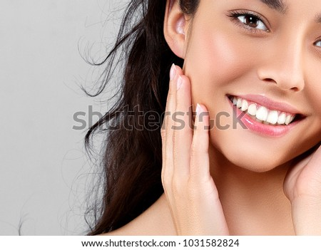 Woman beauty face portrait isolated on gray with healthy skin and white teeth smile. Studio shot. #1031582824