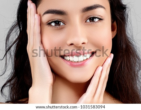Woman beauty face portrait isolated on gray with healthy skin and white teeth smile. Studio shot. #1031583094