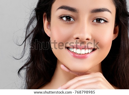 Woman beauty face portrait isolated on gray with healthy skin and white teeth smile. Studio shot. #768798985