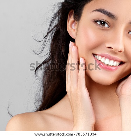 Woman beauty face portrait isolated on gray with healthy skin and white teeth smile. Studio shot. #785571034