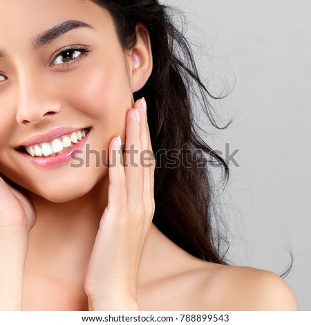 Woman beauty face portrait isolated on gray with healthy skin and white teeth smile. Studio shot. #788899543