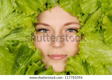 woman beauty face with green salad frame