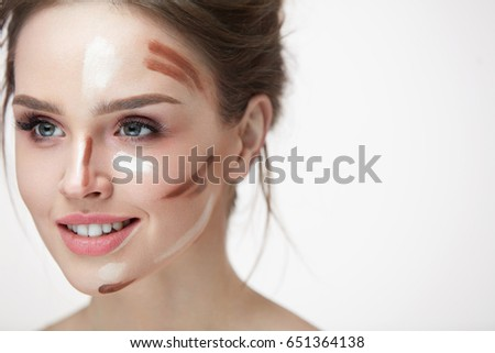 Woman Beauty Makeup. Closeup Of Smiling Young Female Model With Contouring And Highlighting Face Lines On Skin. Portrait Of Beautiful Smiling Girl With Cosmetic Makeup Product On Skin. High Resolution
