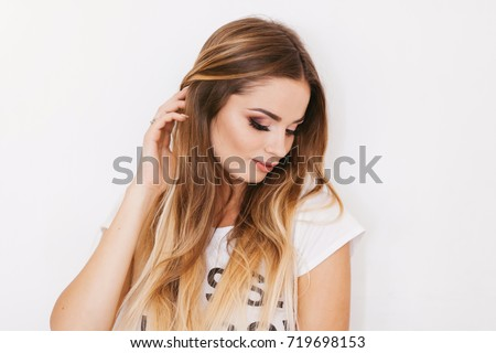 Woman beauty portrait in white T-shirt with word
