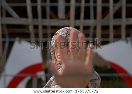 woman behind the fence, close-up of a refugee woman's hand Stockfoto ©
