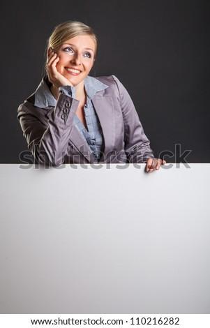 Woman behind white banner on dark gray background