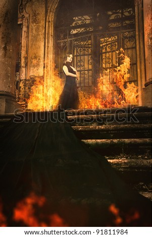 woman beside old burning castle in fabric