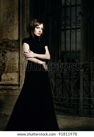 woman beside old castle in fabric