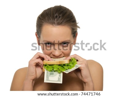 Woman biting a sandwich out of money and lettuce isolated on white