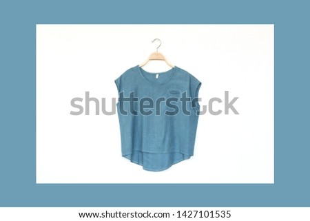 Woman blouse with blue blouse cotton on white and pastel background.