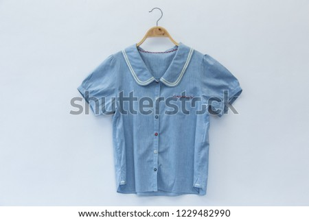 Woman blouse with blue blouse cotton on white background.