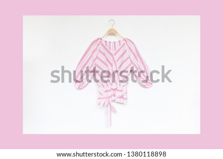 Woman blouse with Pink blouse cotton on white and pastel background.