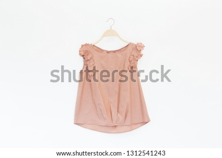 Woman blouse with Pink blouse cotton on white background.