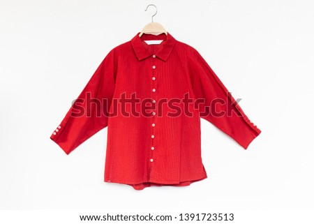 Woman blouse with Red blouse cotton on white background.