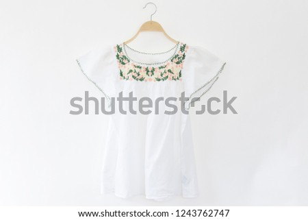Woman blouse with white blouse cotton on white background.
