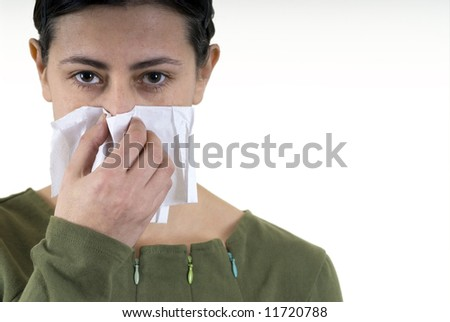 woman blowing her nose with white handkerchief