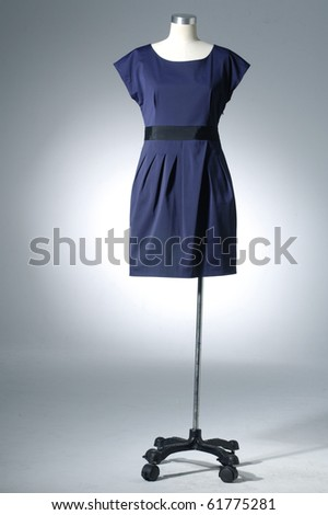 Woman blue cloth on mannequin on light background