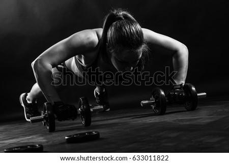 woman bodybuilder lifting...