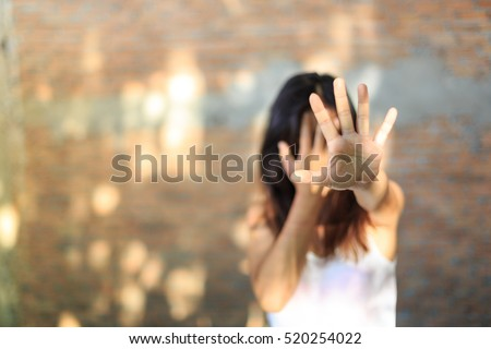Woman bondage in angle of abandoned building image blur , stop violence against Women, international women\'s day
