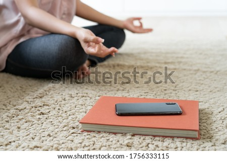 woman break time pose Yoga meditation and turn off mobile phone and disconnect internet  Сток-фото ©