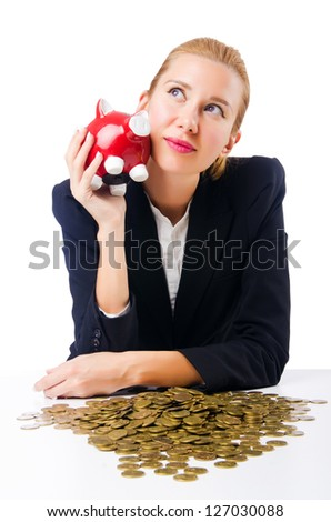 Woman breaking piggy bank for savings - stock photo