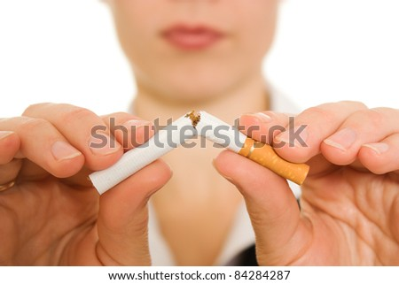 Woman breaks down the cigarette.