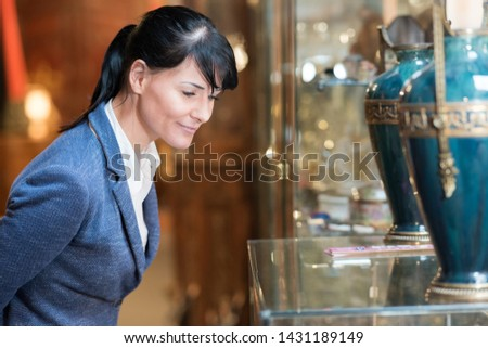 woman browsing in antique shop