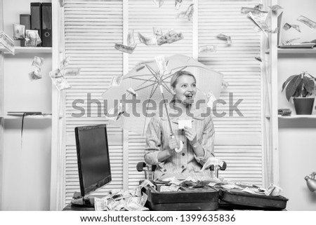 Woman business lady or accountant under umbrella. Financial success. Accountant with pile money hide under umbrella. Accountant enjoy money rain. Money rain concept. Money falling from ceiling.