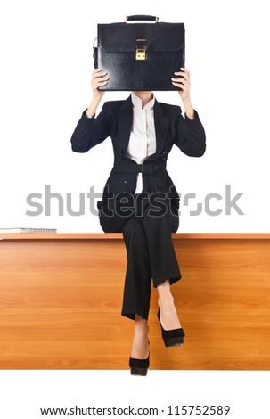 Woman businesswoman sitting on the desk
