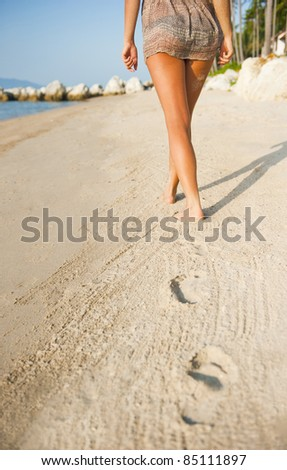 Woman buttocks on the beach